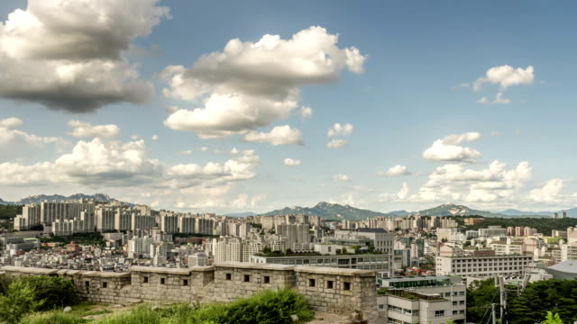 View of cloudscape over Seoul City Wall (also called as Hanyangdoseong and it's Korea Historic Place 10) and cityscape of Seoul city