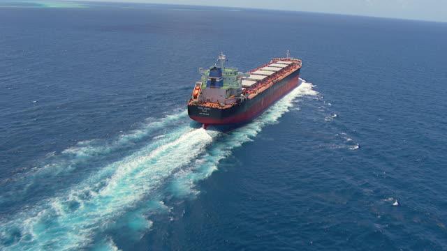 MS AERIAL TU View of coal cargo ship moving in ocean / Queensland, Australia