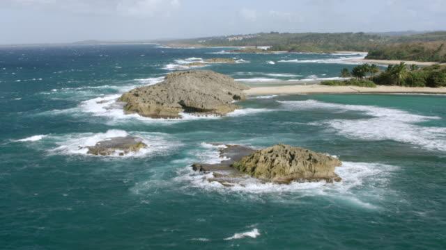 WS AERIAL POV View of coastline and beach / Arecibo, Puerto Rico, United States
