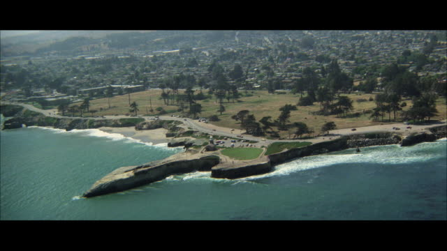WS POV AERIAL View of coastline with two lane highway