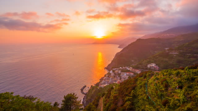 View of colorful city in Cinque Terre, Italy at sunset