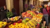 'View of colourful market stalls selling fresh produce, Chachapoyas market, Chachapoyas, Peru [Perú]'