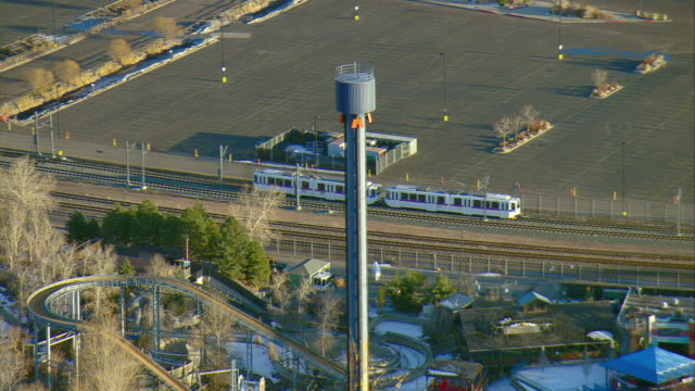 WS PAN ZO View of commuter train to reveal part of Elitch Gardens and Pepsi Center