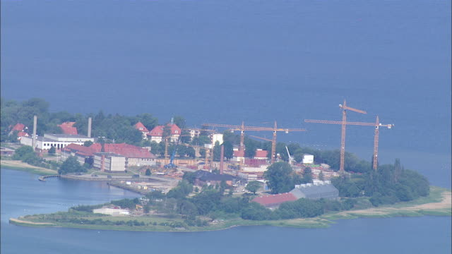 WS AERIAL View of company located on island surrounding by sea / RuegenGreifswaldLubmin, Mecklenburg-Vorpommern, Germany