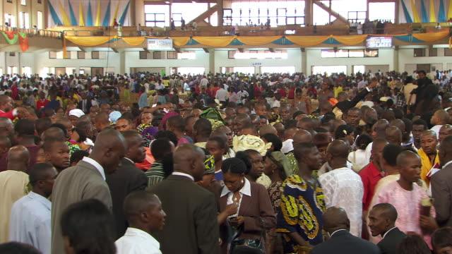 View of congregation praying and leaving church / Lagos Nigeria