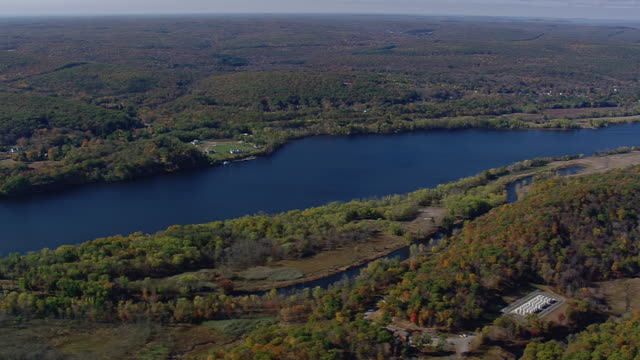 WS AERIAL View of Connecticut River flowing through forest area / Connecticut, United States