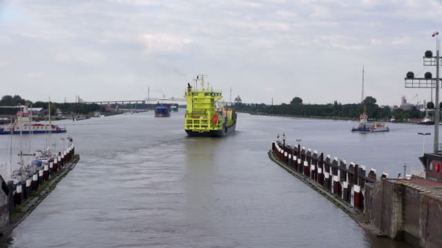 WS POV T/L View of container ship leaving Brunsbuttel Lock of Kiel Canal, Nord-Ostsee-Kanal / Hamburg, Germany
