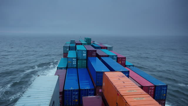 WS POV View of container ship on Baltic Sea (dusk) / At Sea