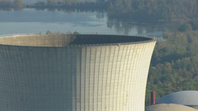 CU AERIAL ZO View of cooling tower at Bellefonte one Nuclear Reactor in Jackson County, two cooling towers and buildings with surrounding landscape / Hollywood, Alabama, United States
