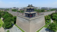 AERIAL View of corner tower of city wall and city skyline/ Xi'an, Shaanxi, China