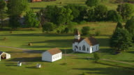 WS AERIAL POV View of Country Church in little town / Warrick County, Rolling Acres, Indiana, United States