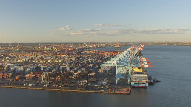 WS AERIAL DS View of cranes and docked container ships at Elizabeth Marine Terminal at port to large ship / Newark, New Jersey, United States