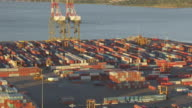 WS AERIAL DS ZI View of cranes with docked container ships at Elizabeth Marine Terminal at port to moving container transporter / Newark, New Jersey, United States