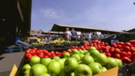 WS View of crates filled with different fruits as people walking at City Market / Kansas City, Missouri, United States