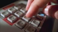 CU PAN SLO MO View of credit card reader key pad / Johnson City, Texas, USA