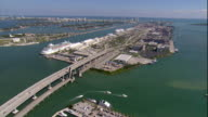 WS POV AERIAL View of cruise ship at dock and highway with Miami skyline in background / Miami, Florida, USA