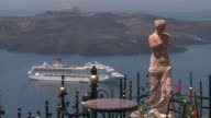 MS View of cruise ship in sea and statue / Santorini, Cyclades Islands, Greece