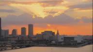 WS PAN ZO POV View of cruise with cityscape at dusk / Miami, Florida, USA