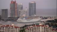 WS ZI ZO POV View of cruise with cityscape at dusk / Miami, Florida, USA