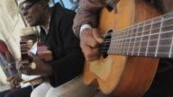 CU View of Cuban musician playing guitar / Havana, Cuba
