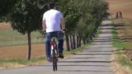 WS View of cyclist on bikeway / Merzig, Saarland, Germany