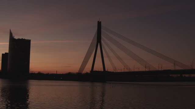 WS PAN View of Daugava River with bridge at sunset / Riga, Latvia