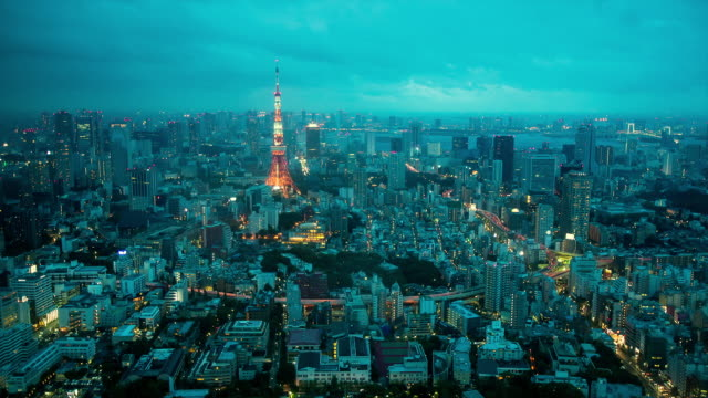 WS T/L View of day to night transition over Tokyo tower and Tokyo bay before upcoming typhoon / Tokyo, Japan