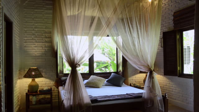 MS View of Decorated hotel room with mosquito net over bed