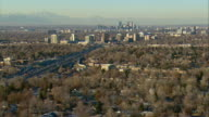 WS POV AERIAL View of Denver suburbs with downtown Denver and Rocky Mountains in distance / Denver, Colorado, USA