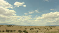 WS TU TD ZI AERIAL View of desert and shrubs and sunny sky with clouds in pueblo county / Colorado, United States