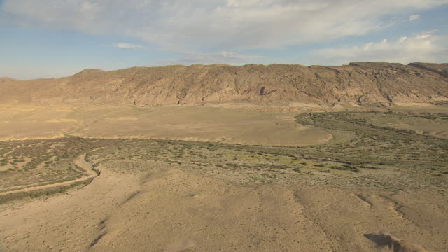 WS AERIAL View of desert with mountains in San Juan County / New Mexico, United States