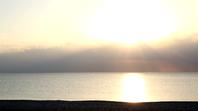 View of deserted beach st sunrise, gentle surf