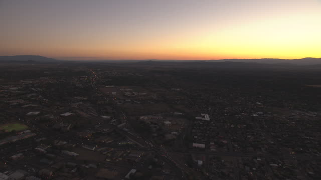 WS AERIAL View of development in valley with sunset / Santa Fe, New Mexico, United States