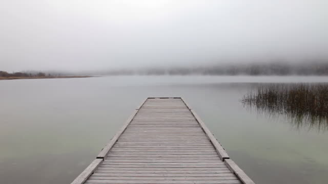 WS View of dock on misty mountain lake / Kalispell, Montana, United States