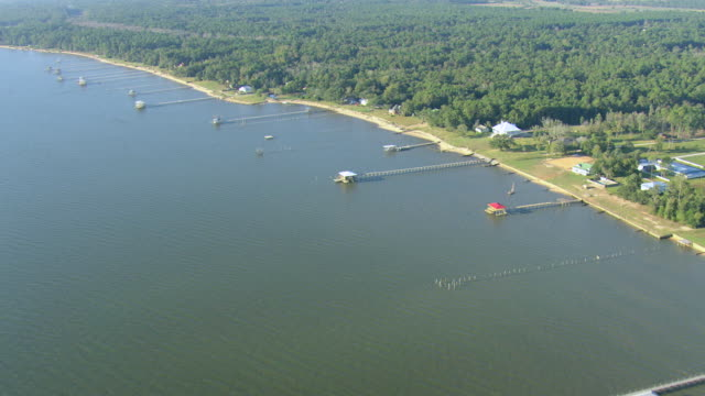 WS AERIAL View of docks with Mobile Bay / Alabama, United States
