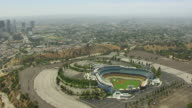 WS AERIAL POV View of Dodger Stadium with downtown Los Angeles in background / Los Angeles, California, United States