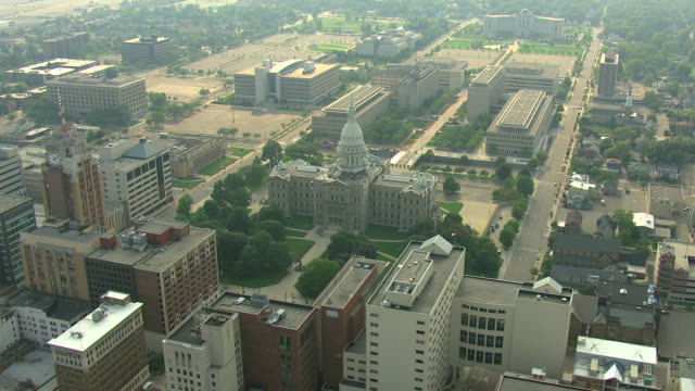 WS AERIAL View of downtown and approach Michigan State Capitol / Lansing, Michigan, United States