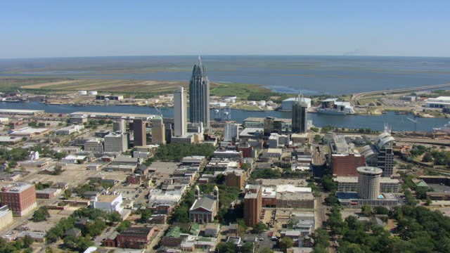 WS AERIAL View of downtown buildings by Mobile River / Mobile, Alabama, United States