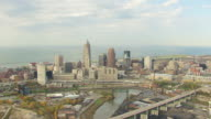 WS AERIAL View of downtown buildings with Lake Erie / Cleveland, Ohio, United States