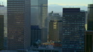 WS PAN View of downtown, buildings with Rocky Mountains in background / Denver, Colorado, USA