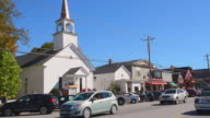 WS View of downtown church on Main Street with stores in Northern New England / North Conway, New Hampshire, United States