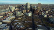 WS POV AERIAL View of downtown Denver with Civic Center Park and Colorado State Capitol in foreground and Rocky Mountains in background / Denver, Colorado, USA