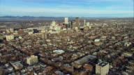 WS POV AERIAL View of downtown Denver with Rocky Mountains behind / Denver, Colorado, USA