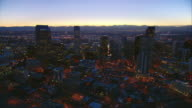 WS PAN View of downtown Denver with traffic and Rocky Mountains / Denver, Colorado, USA