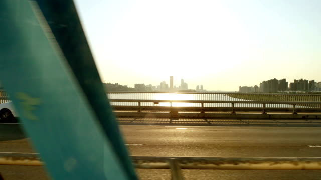 View of Downtown District and Hangang Bridge from Subway train crossing Han river