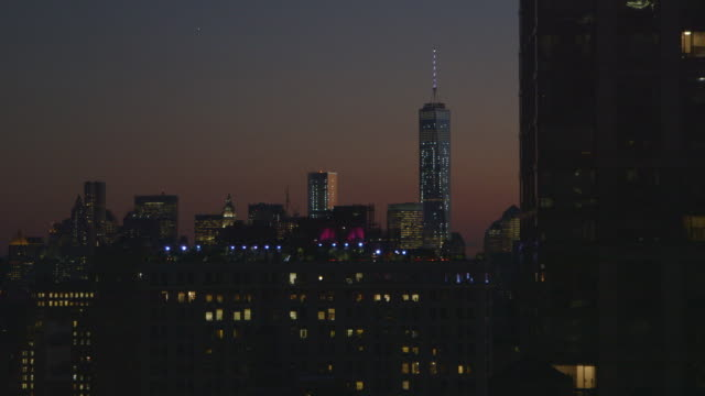 A view of downtown Manhattan and One World Trade Center at Dusk