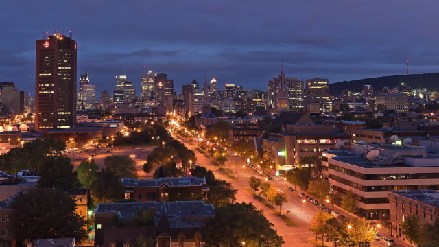 WS T/L View of Downtown Montreal and Mont-Royal from day to night / Montreal, Quebec, Canada