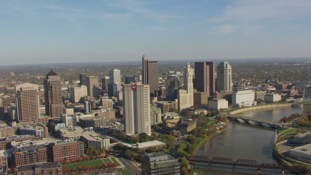 WS AERIAL View of downtown on Scioto River / Columbus, Ohio, United States