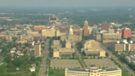 WS AERIAL View of downtown with buildings and Capitol Building / Lansing, Michigan, United States