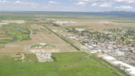 WS AERIAL PAN View of DriggsCity Idaho and farm area / Wyoming, United States